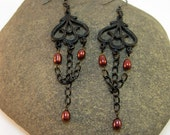 Black chandelier earrings with chain and red pearls