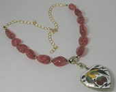 Vintage crane locket on cherry quartz