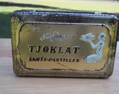 Vintage tins, antique advertising tins, old candy tins, French chocolates, Paris apartment, French pastilles