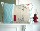 Love life pillow in turquoise and scarlet red