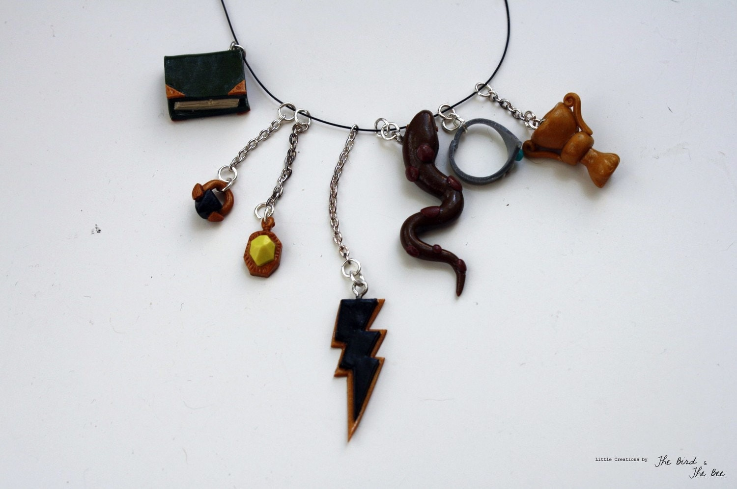 horcruxes charm necklace by thebirdthebee on etsy