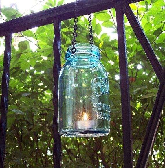 Hanging mason jar lantern or vase made from a vintage ball