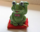 Japanese Creamic Lucky Frog on Pillow.  One Leg Waving.  So Cute.