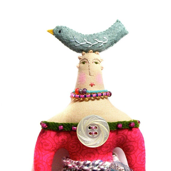 Folk Art Doll with a Bird on top of her Head