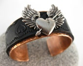 Made to fit you  Broken Heart Concho Leather and Hammered Copper Cuff.  Free shipping to US locations, reduced rates to all other countries.