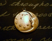 Crescent moon face antique brass  charms     Item 1953