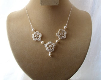Three blooms, crochet necklace with pearls.