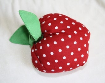 Red apple pincushion
