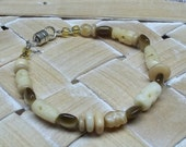 upcycled BeigeCat's eye and bone beads Bracelet ecofriendly reclaimed beads magnetic clasp