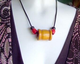 Sale Vintage thread spool Necklace red black wood beads black satin cord treasury item  Season of love