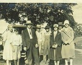 Early 1930s Farm Family Photo Posing With Car Well Dressed Ladies Hats Farmer in Striped Overalls Funny Boy Barn 30s Photograph Snapshot