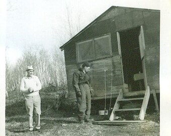 Gone Fishing 2 Men At Camp Lake Cabin Getting Rods Ready Early Spring Cold Weather Fish Camping