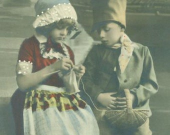 Dutch Boy Girl Wearing Wood Clogs Knitting Hand Tinted Antique Photo Souvenir Postcard Style Photograph Color Colored Clothing