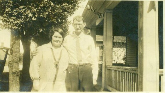 Vintage 1920s 30s Married Couple Photo Standing in Front of House Black and White Photograph Desheveled Clothing