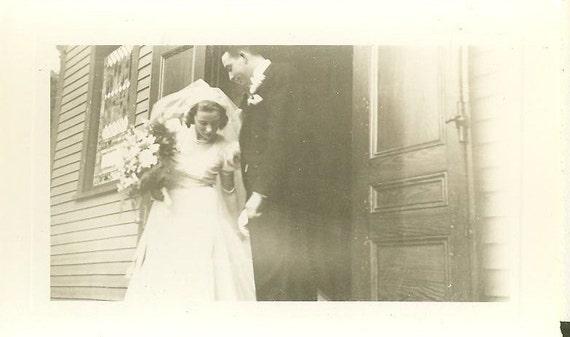 1943 Portland Maine Wedding Photo Bride Fixing Dress White Wedding Gown Veil Gloves Bouquet Church Door With Groom WW2 Era