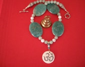 White OM Bone Pendant Inlaid with Turquoise and Red Coral and Strung with Amazonite, Jade and Howlite