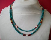 Southwestern Two Strand Turquoise, White Mother of Pearl, Red Coral, Yellow F.W. Pearl, and Shell Hishie with an S Clasp