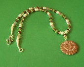 Sparkling and Auspicious this Carved Marble OM Necklace is Full of Light