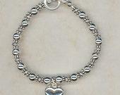 Reserved for Catherine: Sterling Shiny Heart Bracelet & Earrings