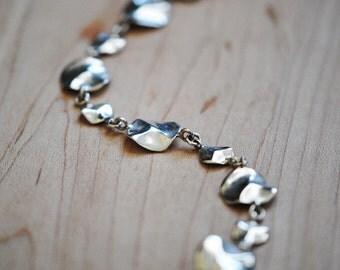 Wavy Disc Bracelet, Sterling Silver, Handcrafted, Carved, Circle, Lilypad, Ocean, Wave, Water. TIDE POOL BRACELET.