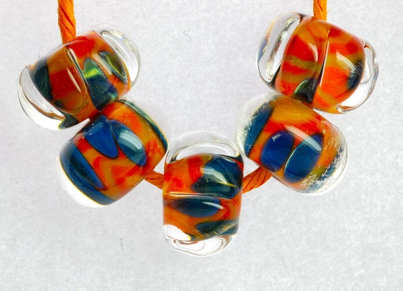 handmade encased boro in bright reds oranges and blue faceted lampwork beads for jewelry making