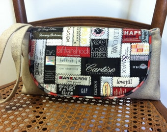 SALE- Was 60.00 Now 40.00 - Linen wristlet clutch with designer label collage flap