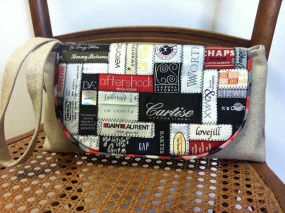 SALE- Was 60.00 Now 40.00 - Linen wristlet clutch with designer label collage flap