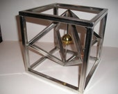 Geometric, abstract stainless steel sculpture