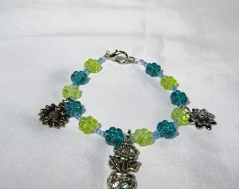 Teal and lime green flower charm bracelet