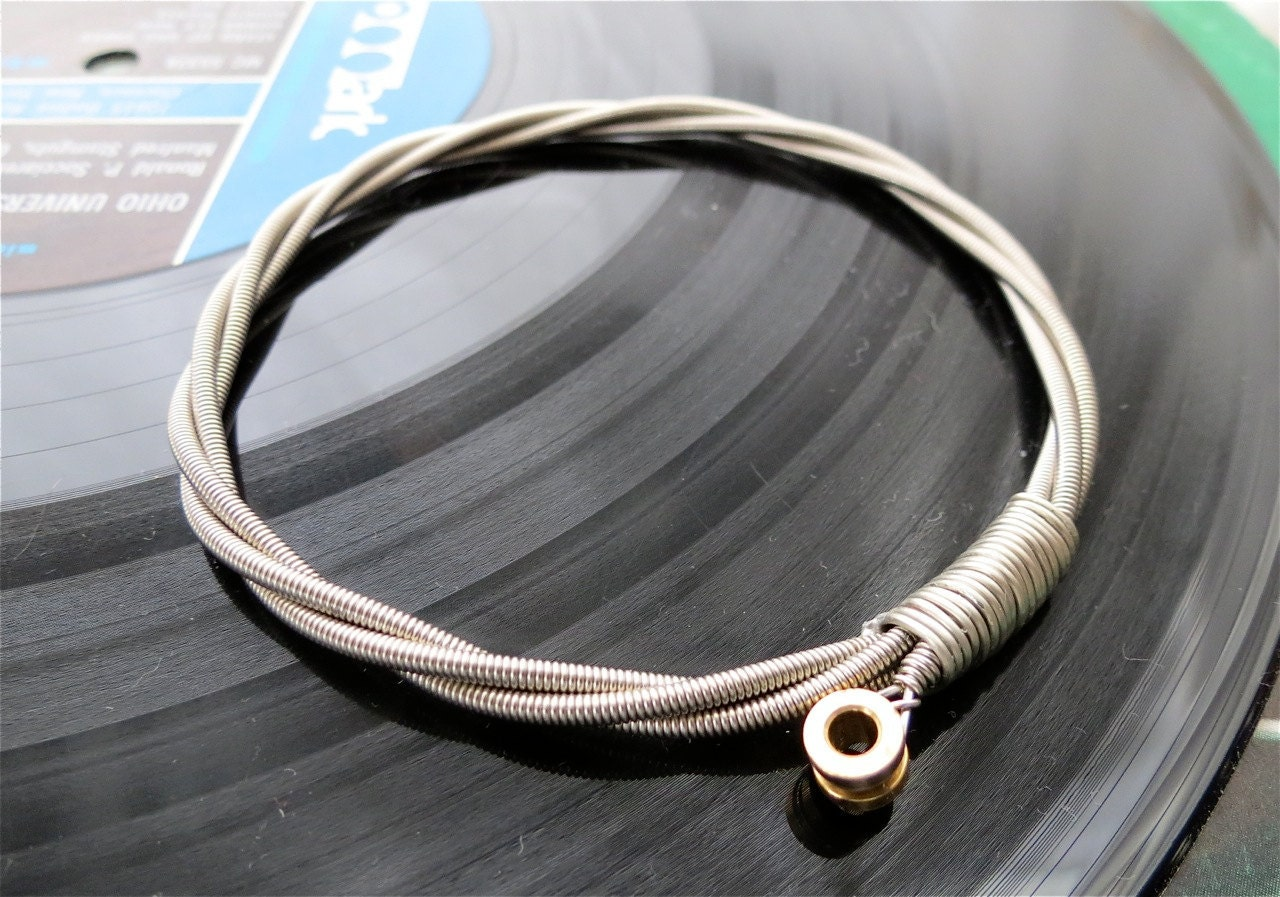 recycled bass guitar string bracelet silver colored with brass. Black Bedroom Furniture Sets. Home Design Ideas