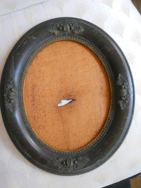Antique Oval Wood Frame with Leaves and Berries