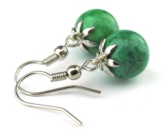EE060110506) Green fossil ball dangling earrings