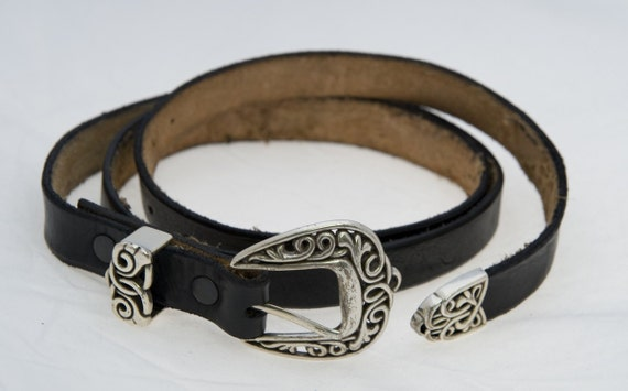 Black leather belt with celtic buckle and tip