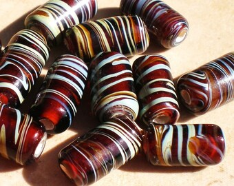 10 glass beads brown cylinder w colored swirls 14x7mm