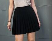 black pleated mini skirt- s