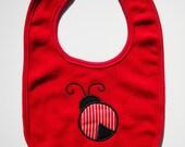 Embroidered lady bug baby bib