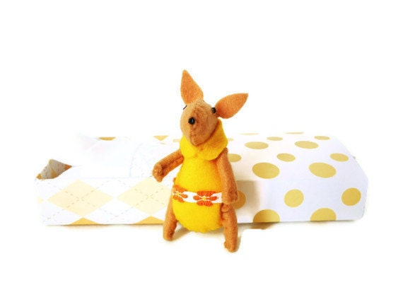 Yellow rabbit critter of the forest with matchbox bed
