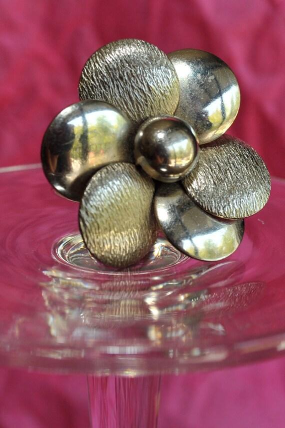 Silver Flower ring. Metal. Repurposed. Adjustable. Spring.