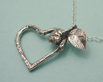 sumac seed and twig heart charm necklace sterling silver twig botanical jewelry