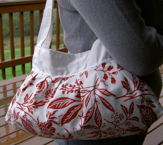Pleated white and red floral purse