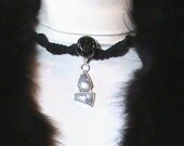 HOWLING AT THE MOON - Indigo Signature Designs.  Stunning hemp necklace choker.  Howlite and sterling  pendant, black glass center bead, black macrame, black hemp, wood beads.