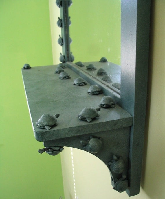 Marching turtle mirror frame