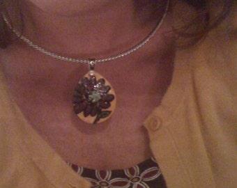 small, teardrop shaped flower pendant