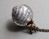 Newspaper Bauble Necklace with Flying Bird Charm on Antique Brass