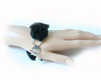 bracelet with black roses and silver toggle clasp ,  fabric bracelet
