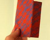 Soft two zip wallet in orange with blue camper vans