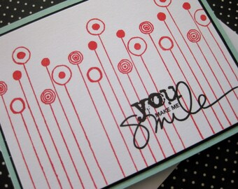 you make me smile with row of red flowers handmade card