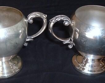 Vintage silver creamer and open sugar bowl