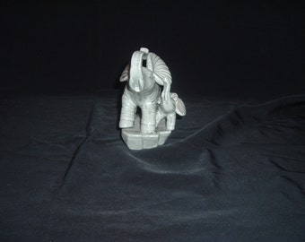porcelain elephant and baby