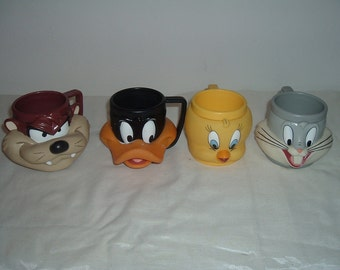 four collectable cartoon cups